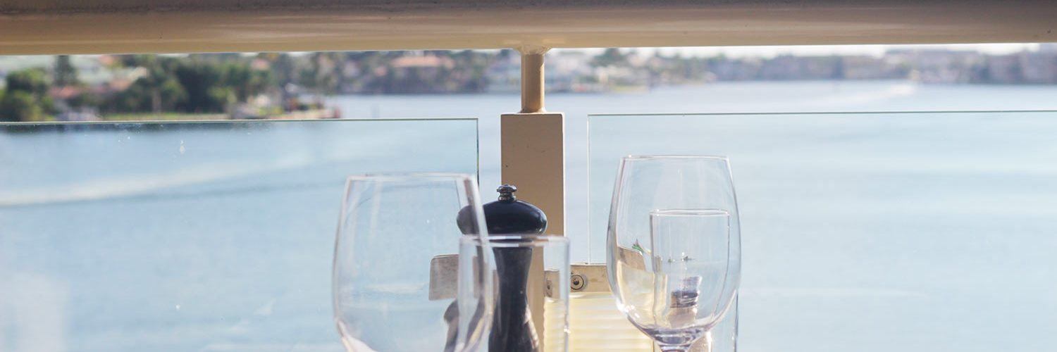 Bayside table for 2 overlooking water close-up